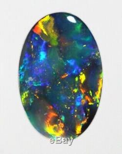 (1956) Bright Blue/Green/Gold Solid Black Opal 1.19cts