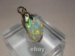2.3 ct Solid Australian Semi Black Opal Pendant 14k Yellow gold