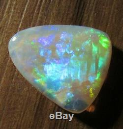 4.2ct. COOBER PEDY SOLID CRYSTAL OPALBRIGHT GREEN/GOLD/BLUE BROADFLASH FIRE