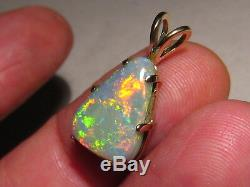 Charming 5.8 ct. Semi Black Opal Pendant solid 14 kt yellow gold