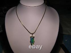 Charming 6.3 ct Black Opal Pendant solid 14 kt yellow gold