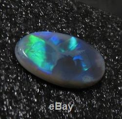 HUGE 16ct. LIGHTNING RIDGE SOLID BLACK OPALSUPERB GREEN/BLUE FLASH FIRE PATTERN