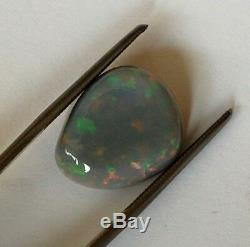 Huge Loose Ethiopian Solid Natural Semi-black Opal 9.05 Carat Green Red Flash