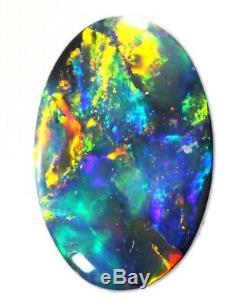 (1956) Lumineux Bleu / Vert / Solid Gold Black Opal 1.19cts
