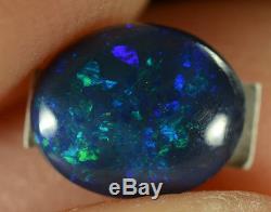 Opale Noire Australienne Naturelle Solide 0.45ct Très Brillante Électrique Violet / Vert