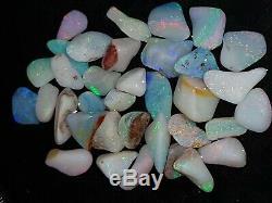 Un Colis Naturel De 97,5 Ct, Opale Coedy Coober Pedy Frotte Les Rouges, Orange, Bleu, Vert